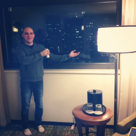 My friend Ian Riggins gesturing grandly at one of the few views we got of Boston—from our hotel room.